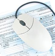computer mouse on tax document
