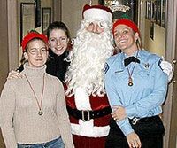 Police Officer and civilian staff pose with Santa